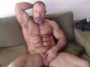 Muscular Mature Guy Flexing His Massive Arms And Wanking