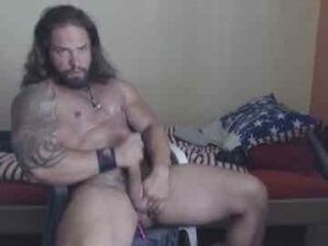 Long Haired Hunk With Huge Biceps Cums On Cam